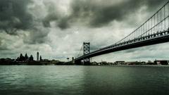 Under cloudy sky,the famous Benjamin Franklin Bridge, Philadelphia, USA Stock Footage