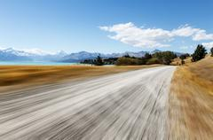 Empty rural road through pasture in fine day in new zealand Kuvituskuvat