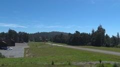 Aircraft Landing on rural private runway in northern California. Stock Footage