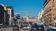 Busy sunny city traffic time lapse with distant crane. Moscow Sadovoe ring Stock Footage