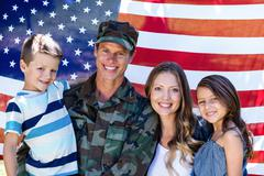 American soldier reunited with his family - stock photo