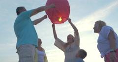 Big family launching sky lantern Stock Footage