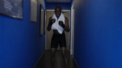 4K MMA fighter alone in corridor, psyching himself up before a fight Stock Footage