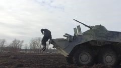 RUSSIA ST.PETERBURG- : soldier jumps from armored infantry vehicle in Stock Footage