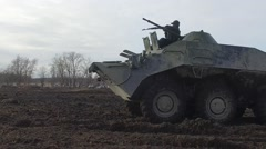 RUSSIA ST.PETERBURG- : soldier inspects a weapon in armored infantry Stock Footage