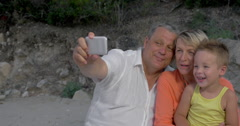 Grandparents Taking Selfie Shot with Grandson Stock Footage