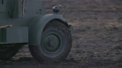 Old military truck goes through the countryside - stock footage