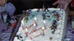 1964: Happy birthday David birthday cake candles kids party. Stock Footage