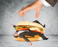 Businessman inside hamburger Stock Photos