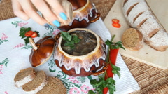 Add pepper to the soup in a pot on a Russian holiday table. Stock Footage