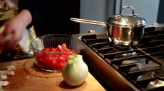 Preparing fresh vegetables, cut fennel and cherry tomatoes Stock Footage