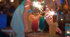 Close-up of three cocktails decorated with sparklers - stock footage