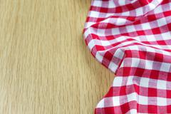 Checked tablecloth is on the wooden table Stock Photos
