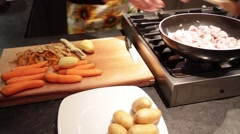 Stew meat preparation with potatoes and carrots, cut and flouring Stock Footage