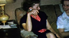 1963: Sisters laughing couch family gathering smiling happy times. Stock Footage