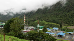Landslide on a steep mountain slope threatens  an oil pipeline pumping station Stock Footage