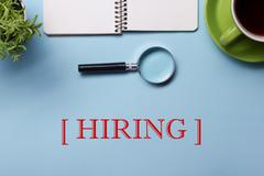 Headhunting Hiring HR Human Resources Position Concept. Office supplies on desk Stock Photos