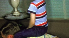 1963: Boy riding dad around living room past floor tube tv. Stock Footage