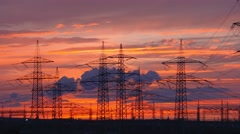 Time lapse video clip: Electrical tower in a sunset with clouds in 4K / UHD - stock footage