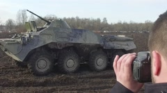 Photojournalist takes photographs of armored infantry vehicle in war zone Stock Footage