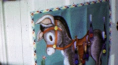 1963: Pin tail on donkey game blindfolded kids birthday party. Stock Footage