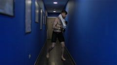 4K MMA fighter alone in corridor, psyching himself up before a fight - stock footage