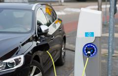 Electric car at charging station Stock Photos