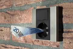 Outlet with money in it Stock Photos