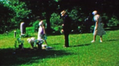 1963: Family visits gravesite beloved pray respect empathy. Stock Footage