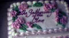 1964: The gathering of the clan cake decoration pink rose flowers. Stock Footage