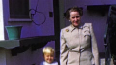 1964: Grandma babysitting hyper blonde toddler date on the town. Stock Footage