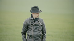 A man in a leather jacket and hat Stock Footage