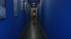 4K Female MMA fighter alone in corridor, psyching herself up before a fight - stock footage