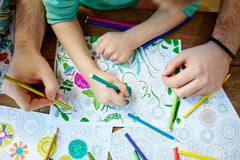 Coloring with crayons Stock Photos
