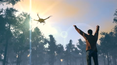 Figure in forest waving to UAV drone Stock Footage