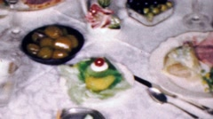 1961: Family formal dining feast plates of appetizers foods. - stock footage