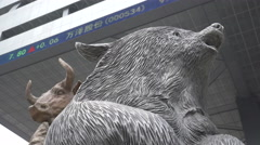 China commodity trading, bull and bear statue at Shenzhen stock exchange Stock Footage