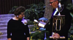 1961: Judges deciding trophy merits for special awards ceremony. - stock footage