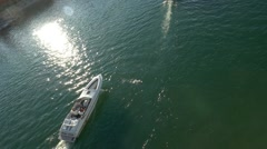 Overhead shot of a speed boat passing in Lake Havasu City, AZ - stock footage