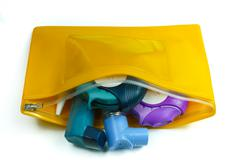 Asthma relief concept, salbutamol inhaler, another medication and yellow medi - stock photo