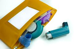 Asthma relief concept, salbutamol inhaler, another medication and yellow medi Stock Photos