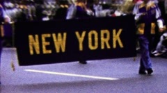 1960: New York state parade introduction sign marching band. - stock footage