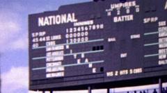 1963: Wrigley field baseball scoreboard cubs v st. louis. Stock Footage