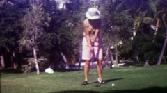1963: Women golfer drives ball from 1st tee at golf course. - stock footage