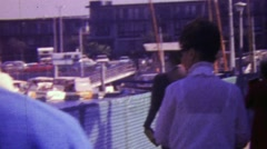 1964: Buyers inspecting boat harbor property rentals for sale. - stock footage