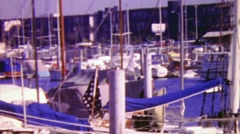 1964: Boat harbor sailboat yachts marina wealthy summer party. Stock Footage