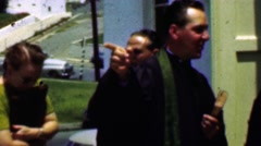 1957: Priest giving restaurant location advise outside community church. Stock Footage