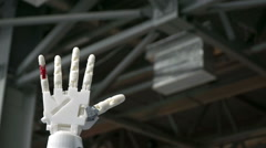 Cybernetic robot arm, which controls the people.  Stock Footage