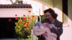 1957: Loving mother holds precious bundled newborn baby. Stock Footage