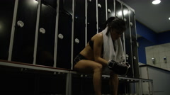 4K Female MMA fighter alone in locker room, psyching herself up before a fight.  Stock Footage